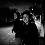 Two sisters, Patty & Cecilia, running to catch the bus to go to work in the early morning . Piedras Negras, Mx 1994.